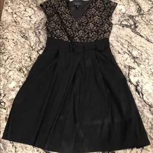 Black dress with gold flowers